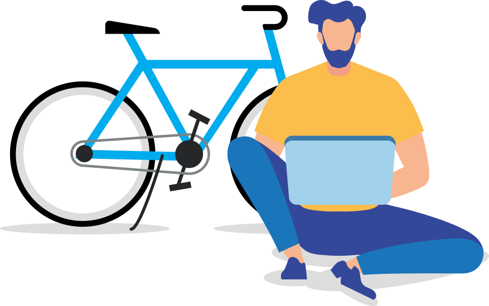 man on laptop in front of bike